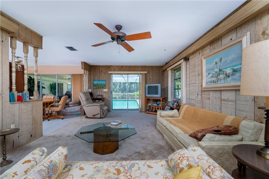 From far wall of family room looking to pool - Single Family Home for sale at 359 Renoir Dr, Osprey, FL 34229 - MLS Number is N6106429