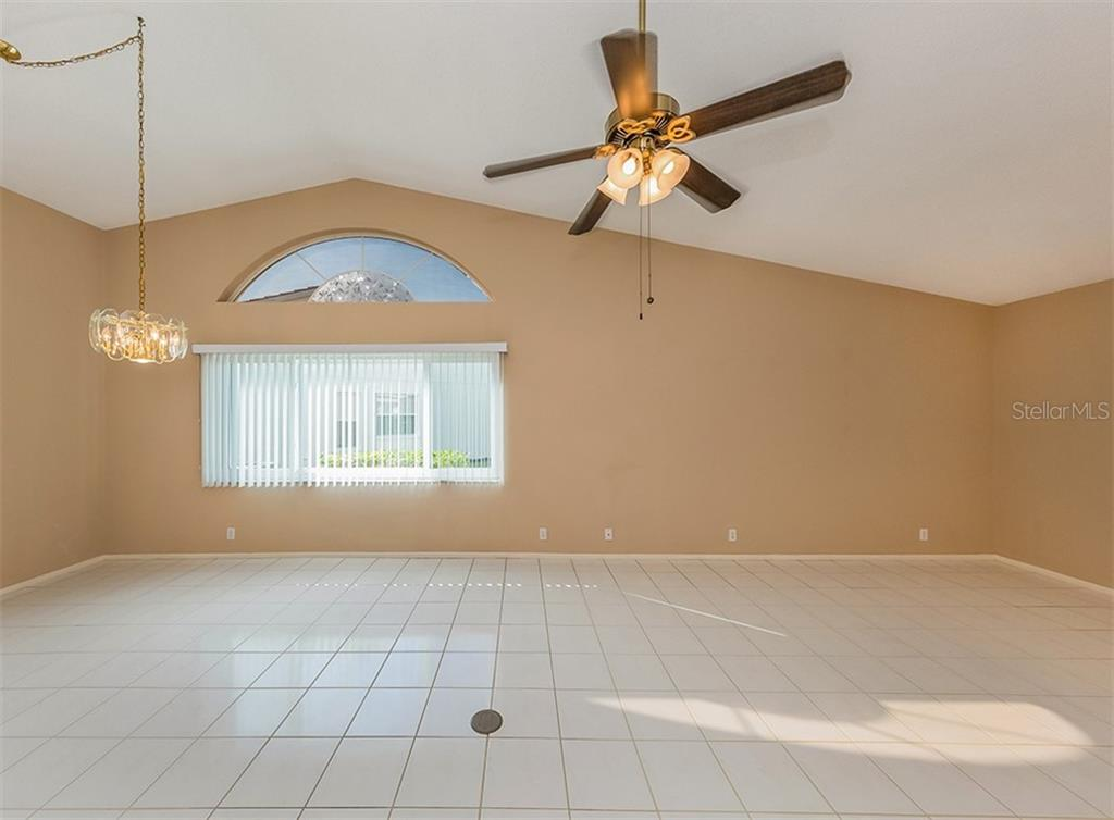 Living room, dining room - Single Family Home for sale at 4822 Limetree Ln, Venice, FL 34293 - MLS Number is N6106780