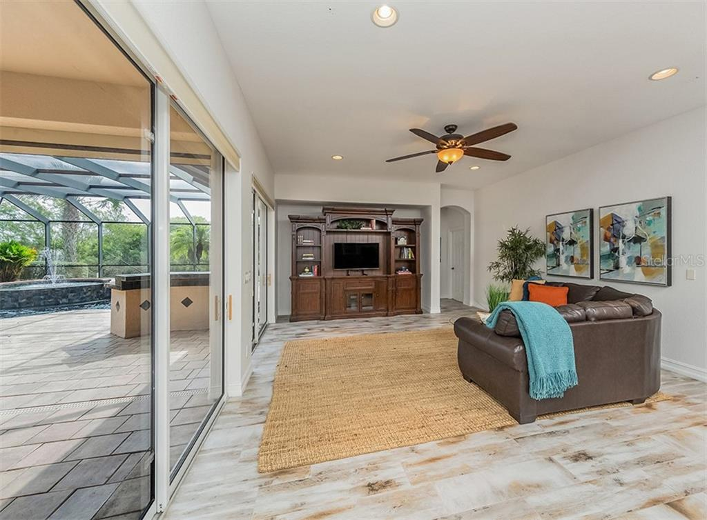 Great room. - Single Family Home for sale at 262 Pesaro Dr, North Venice, FL 34275 - MLS Number is N6107589