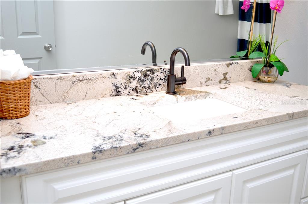 Closer view of the new level 4 granite, jacuzzi faucet, and rectangle sink. So much counter space thanks to the large white vanity! - Single Family Home for sale at 1656 La Gorce Dr, Venice, FL 34293 - MLS Number is N6107911