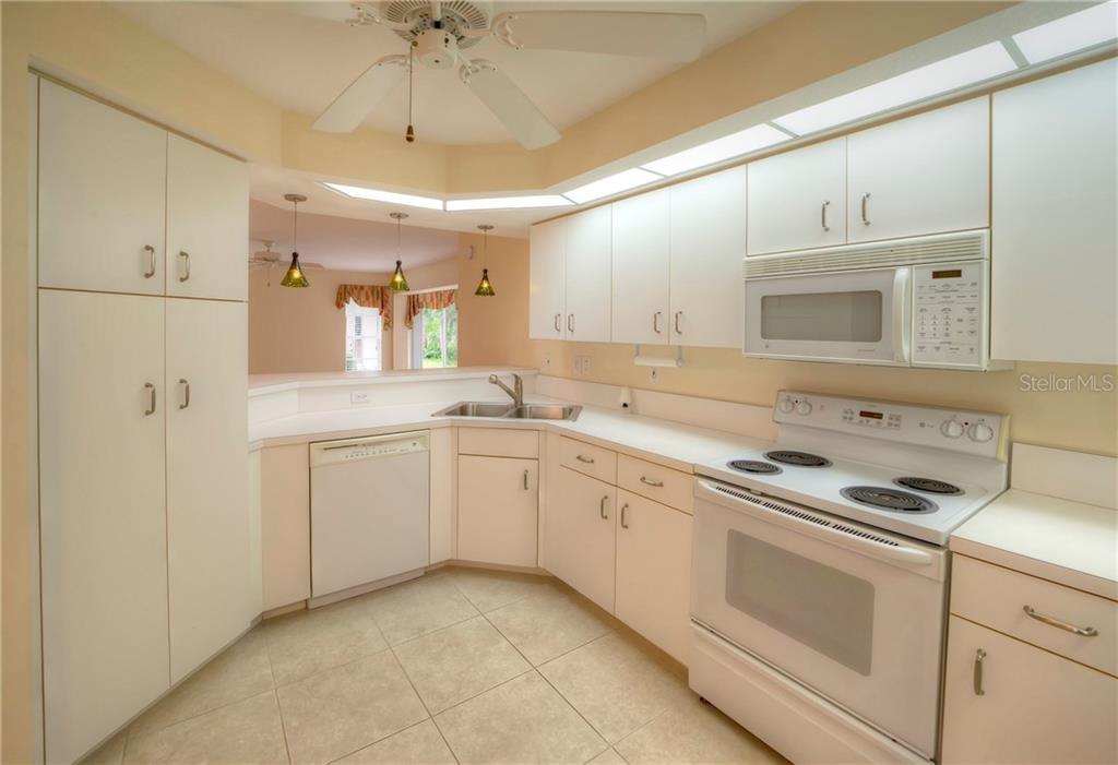 Kitchen with Pantry - Condo for sale at 815 Montrose Dr #101, Venice, FL 34293 - MLS Number is N6107969