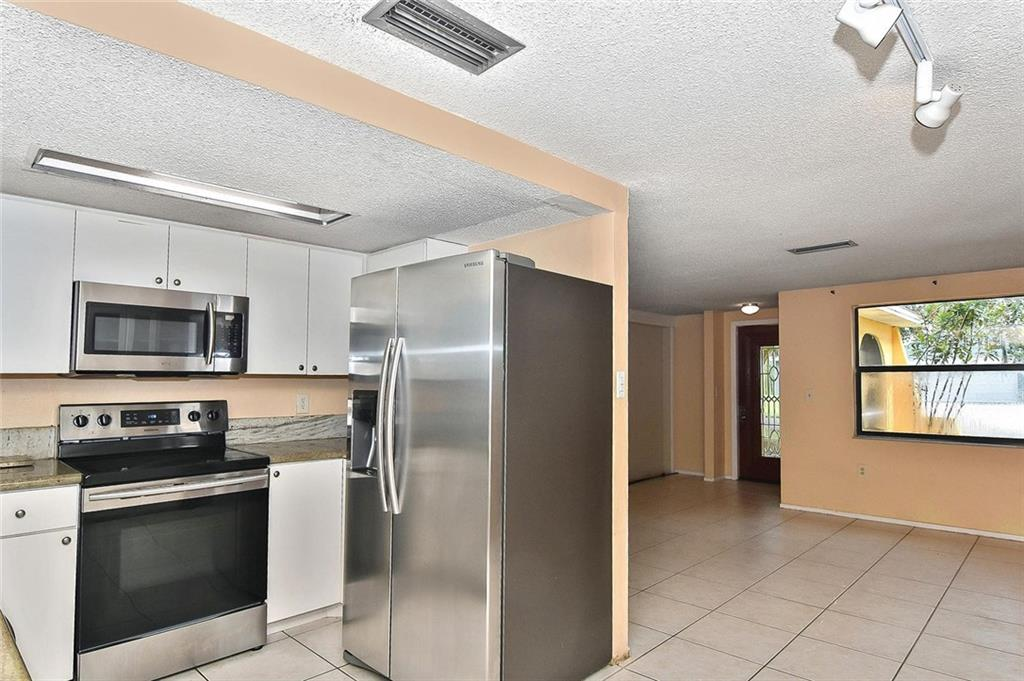 Kitchen to living room - Single Family Home for sale at 615 Lehigh Rd, Venice, FL 34293 - MLS Number is N6108175