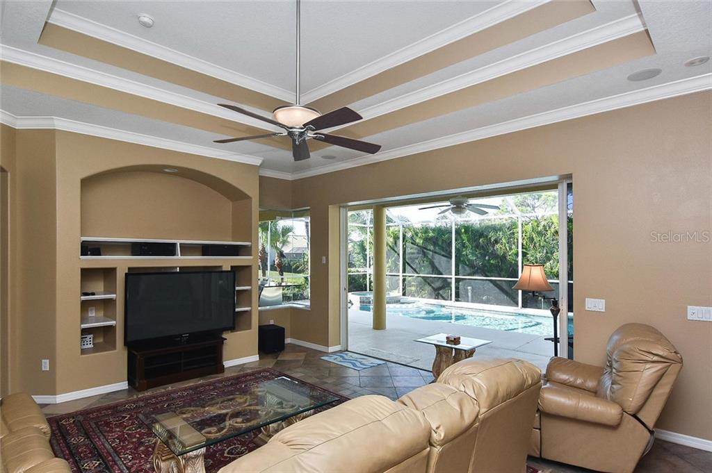 Family room with sliders to pool - Single Family Home for sale at 321 Dulmer Dr, Nokomis, FL 34275 - MLS Number is N6108685