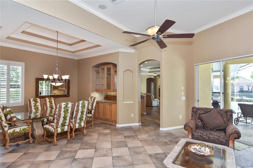 Dining room, living room - Single Family Home for sale at 321 Dulmer Dr, Nokomis, FL 34275 - MLS Number is N6108685