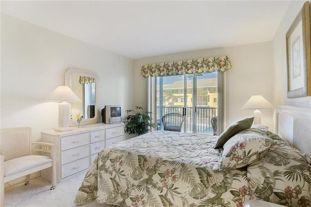 Guest bedroom - Condo for sale at 1150 Tarpon Center Dr #203, Venice, FL 34285 - MLS Number is N6108842