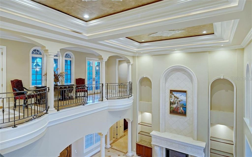 Upper level gallery overlooking the living room - Single Family Home for sale at 8257 Archers Ct, Sarasota, FL 34240 - MLS Number is N6109007