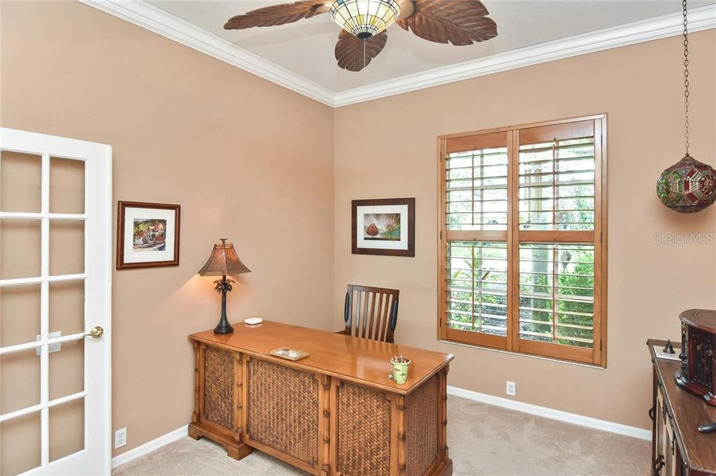 Bright office/den with large window - Single Family Home for sale at 7185 N Serenoa Dr, Sarasota, FL 34241 - MLS Number is N6109058