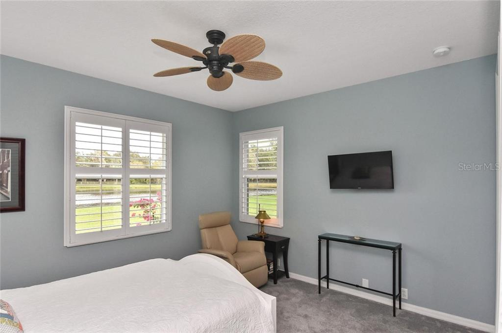 Bedroom 4 with great lake views - Single Family Home for sale at 7185 N Serenoa Dr, Sarasota, FL 34241 - MLS Number is N6109058