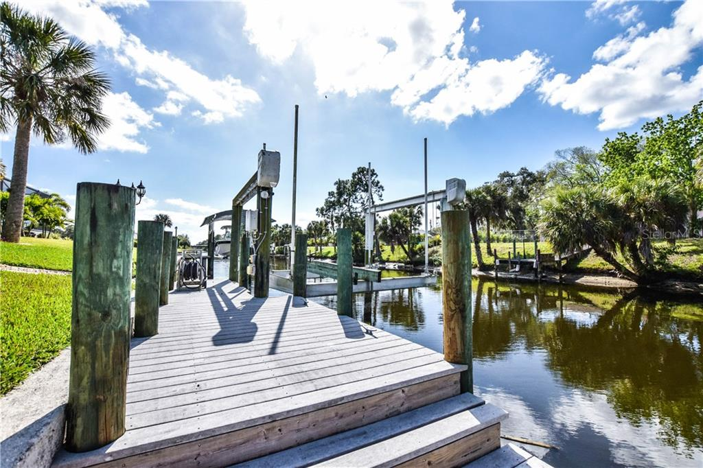 Boat dock. - Single Family Home for sale at 2560 Pebble Creek Pl, Port Charlotte, FL 33948 - MLS Number is N6109100