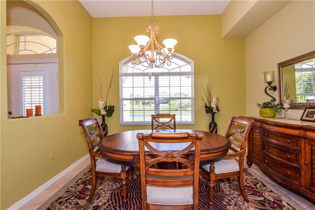 Dining room. - Single Family Home for sale at 2560 Pebble Creek Pl, Port Charlotte, FL 33948 - MLS Number is N6109100