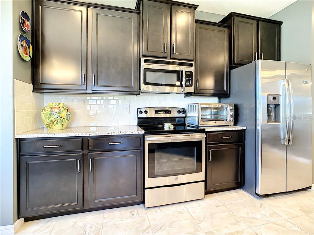 Kitchen with Nice Subway Tile and Stainless Steel Appliances - Condo for sale at 3211 Oriole Dr #104, Sarasota, FL 34243 - MLS Number is N6109438