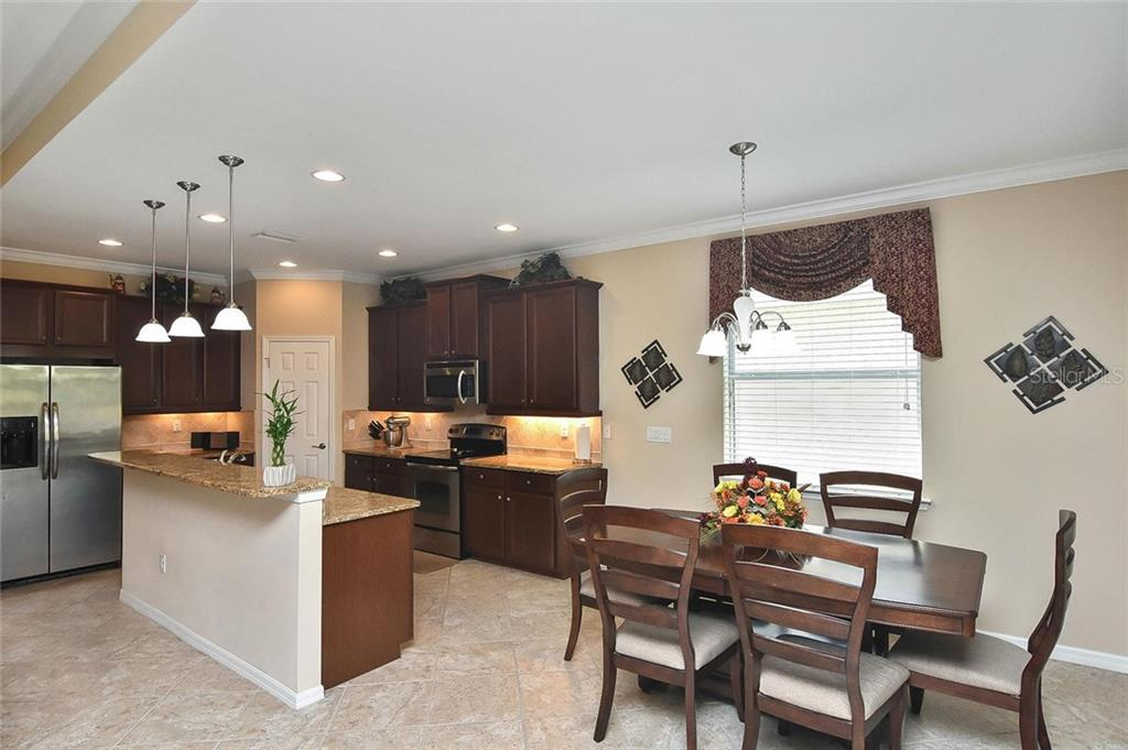 Dining room, kitchen - Single Family Home for sale at 5093 Layton Dr, Venice, FL 34293 - MLS Number is N6109788