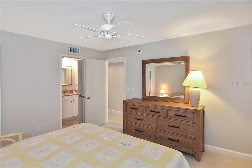 Guest bedroom to guest bathroom - Condo for sale at 862 Golden Beach Blvd #862, Venice, FL 34285 - MLS Number is N6110157