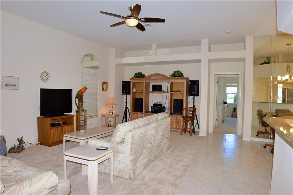 Great room - Single Family Home for sale at 413 Pebble Creek Ct, Venice, FL 34285 - MLS Number is N6110166