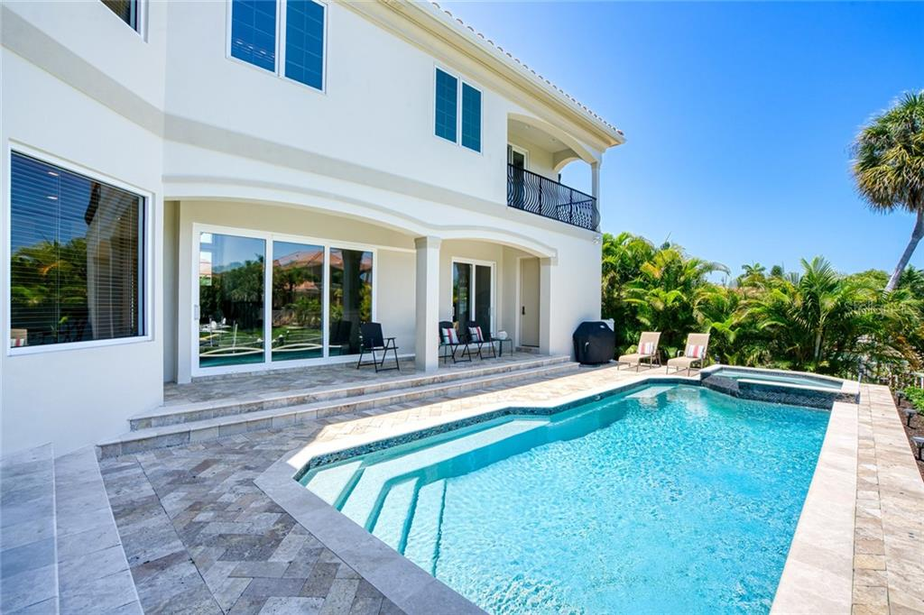 View from Pool to home - Single Family Home for sale at 510 Bowsprit Ln, Longboat Key, FL 34228 - MLS Number is N6110334