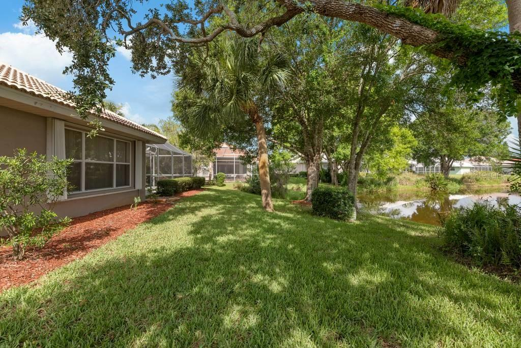 Yard, rear exterior - Single Family Home for sale at 498 Pine Lily Way, Venice, FL 34293 - MLS Number is N6110849