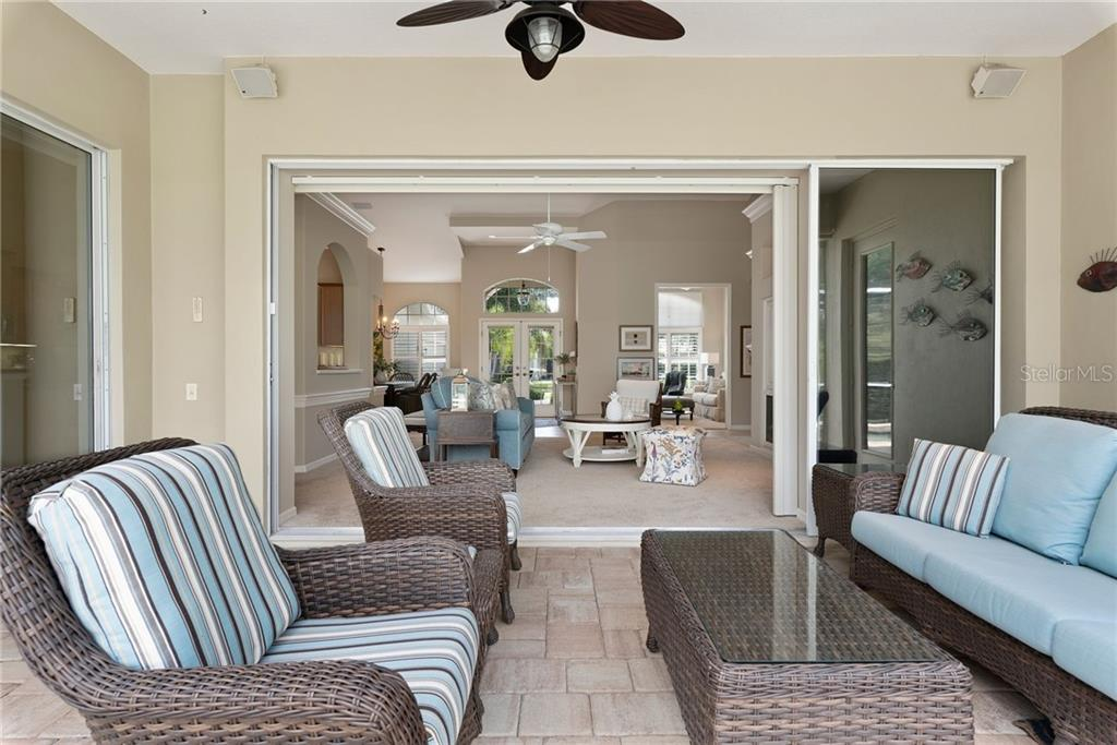 Lanai looking into the great room - Single Family Home for sale at 953 Chickadee Dr, Venice, FL 34285 - MLS Number is N6111180