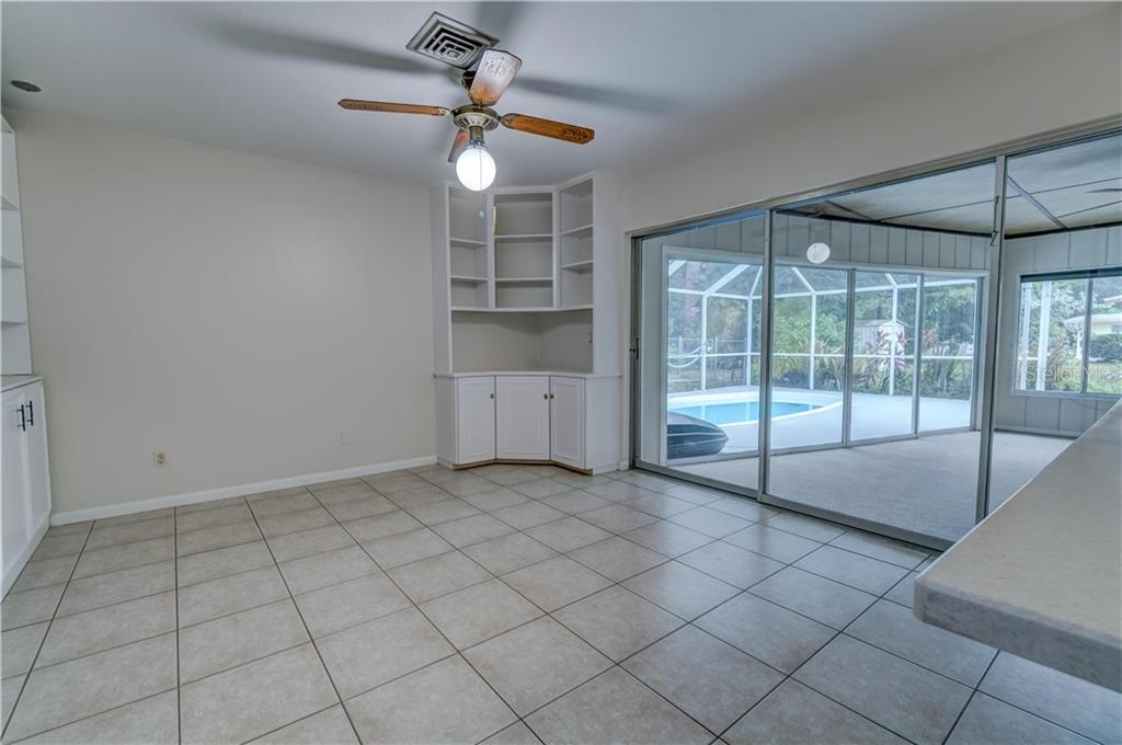 Breakfast Nook or Family Room - Single Family Home for sale at 158 Golf Club Ln, Venice, FL 34293 - MLS Number is N6111200