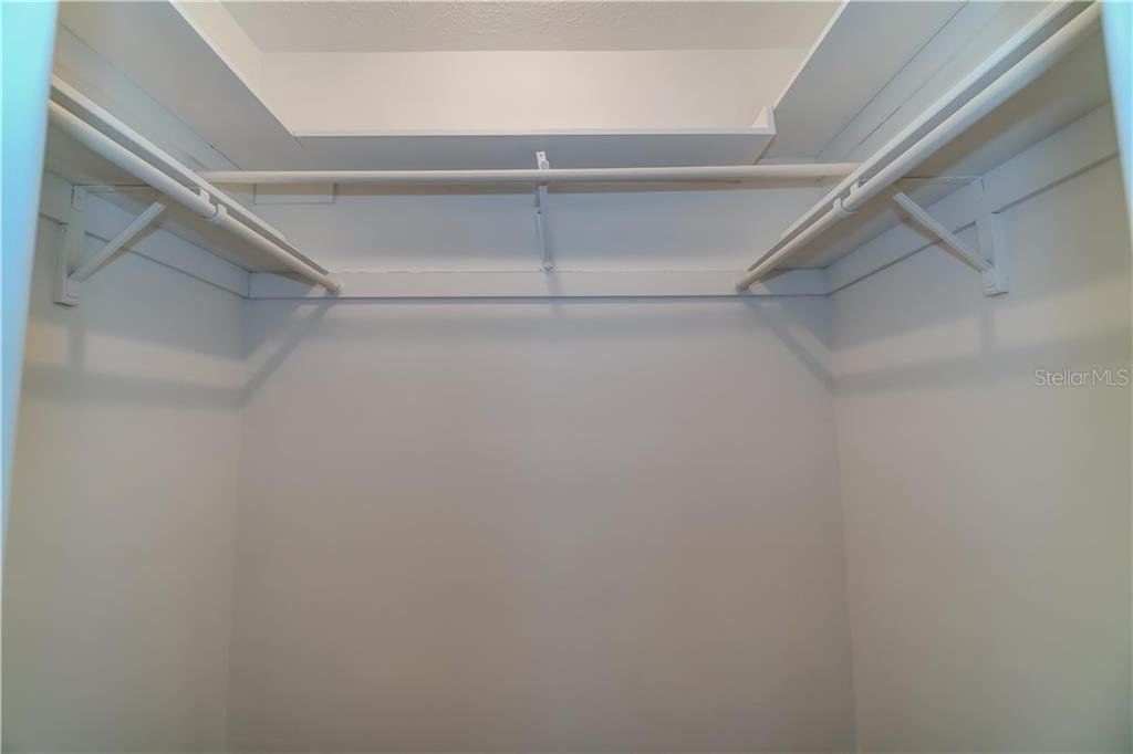 Master bedroom walk in closet - Single Family Home for sale at 158 Golf Club Ln, Venice, FL 34293 - MLS Number is N6111200