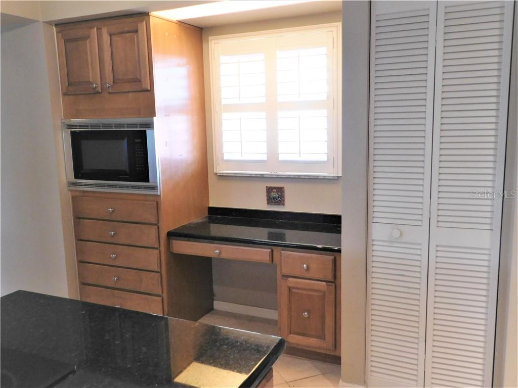 Kitchen with built in desk - Villa for sale at 743 Harrington Lake Dr N #29, Venice, FL 34293 - MLS Number is N6111290