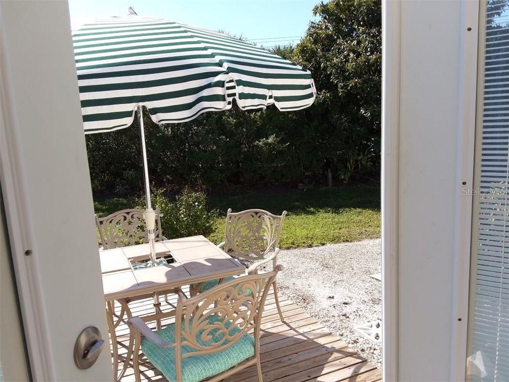 This is where you will enjoy your morning coffee  and it is just steps from the kitchen - Single Family Home for sale at 707 S Green Cir #71, Venice, FL 34285 - MLS Number is N6111316