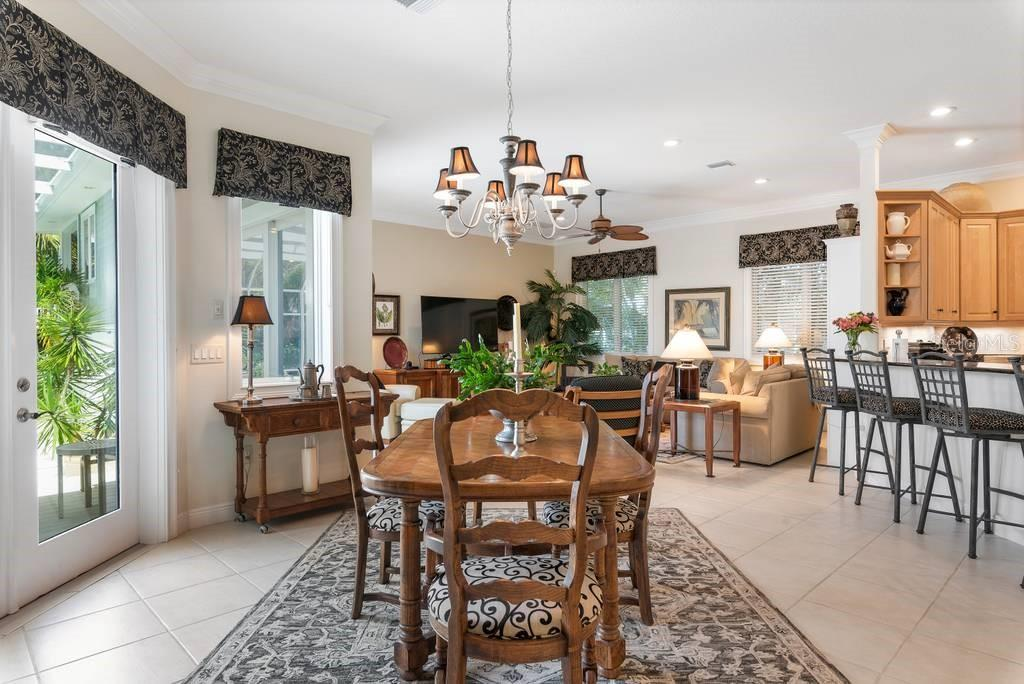 Dining room to family room - Single Family Home for sale at 725 Eagle Point Dr, Venice, FL 34285 - MLS Number is N6111842
