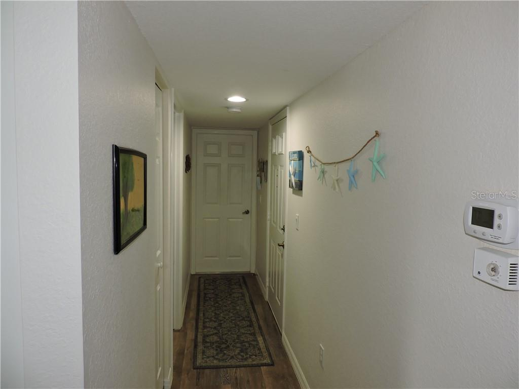 Hallway Entry - Condo for sale at 1041 Capri Isles Blvd #121, Venice, FL 34292 - MLS Number is N6112042