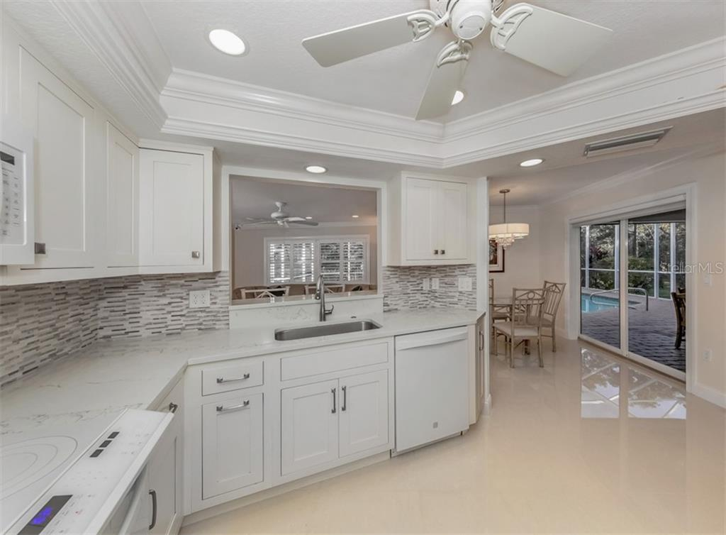 Kitchen to dinette - Single Family Home for sale at 1321 Guilford Dr, Venice, FL 34292 - MLS Number is N6113272