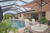 Extended pool decking giving plenty of space for entertaining and dining outdoors. - Single Family Home for sale at 13210 Amerigo Ln, Venice, FL 34293 - MLS Number is N5913012