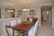 Dining room to foyer - Single Family Home for sale at 9124 Coachman Dr, Venice, FL 34293 - MLS Number is N5914408