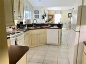 Elegant kitchen, looking toward the large family room and casual eating nook - Single Family Home for sale at 4265 Irdell Ter, North Port, FL 34288 - MLS Number is N5915255