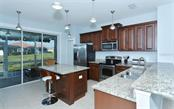 Kitchen - Villa for sale at 10889 Lerwick Cir, Englewood, FL 34223 - MLS Number is N5916198