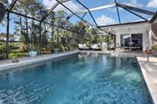 Gorgeous pool view with plenty of travertine decking. - Single Family Home for sale at 405 Sunset Dr, Venice, FL 34285 - MLS Number is N5917234