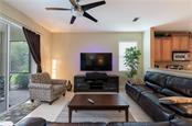 Family room - Single Family Home for sale at 11513 Dancing River Dr, Venice, FL 34292 - MLS Number is N6100495
