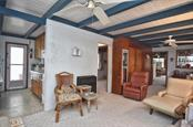 Living room to kitchen - Single Family Home for sale at 616 S Casey Key Rd, Nokomis, FL 34275 - MLS Number is N6100721