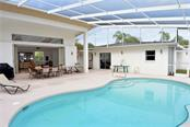 Pool to in-law suite and main house - Single Family Home for sale at 609 Armada Rd N, Venice, FL 34285 - MLS Number is N6102952