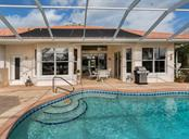Pool, lanai - Single Family Home for sale at 627 Lakescene Dr, Venice, FL 34293 - MLS Number is N6103268