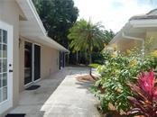 SIDE OF HOME AND PATIO - Villa for sale at 572 Clubside Cir #34, Venice, FL 34293 - MLS Number is N6105221