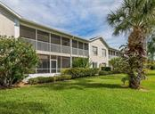 Rear exterior - Condo for sale at 891 Norwalk Dr #205, Venice, FL 34292 - MLS Number is N6108169