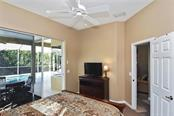Bedroom with slider to lanai/pool - Single Family Home for sale at 321 Dulmer Dr, Nokomis, FL 34275 - MLS Number is N6108685