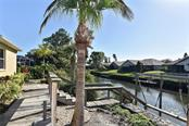 Stairs to dock, canal - Single Family Home for sale at 321 Dulmer Dr, Nokomis, FL 34275 - MLS Number is N6108685