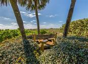 Bench on the way to the beach - Single Family Home for sale at 717 Valencia Rd, Venice, FL 34285 - MLS Number is N6109082