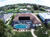 Aerial. - Single Family Home for sale at 2560 Pebble Creek Pl, Port Charlotte, FL 33948 - MLS Number is N6109100