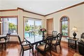 Dining Area with Pool View. - Single Family Home for sale at 510 Bowsprit Ln, Longboat Key, FL 34228 - MLS Number is N6110334
