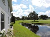 back view of the golf course - Condo for sale at 1041 Capri Isles Blvd #121, Venice, FL 34292 - MLS Number is N6112042