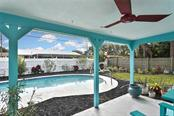 Covered patio, pool, yard - Single Family Home for sale at 991 Kimball Rd, Venice, FL 34293 - MLS Number is N6113781