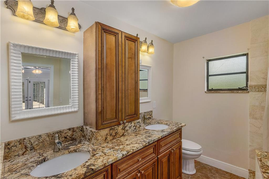 Master Bathroom Featuring 2 Vanities, Tiled Sit Down Stand Up Shower, And A  Walk