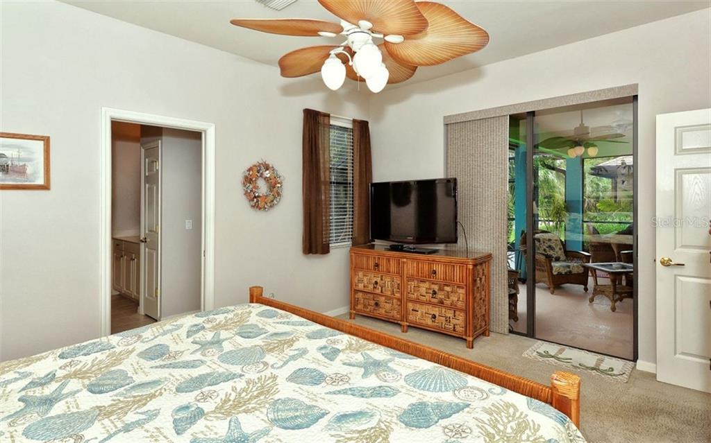 Master Bedroom Opens to Lanai/Pool Space - Single Family Home for sale at 1141 Arbroid Dr, Englewood, FL 34223 - MLS Number is D6101353