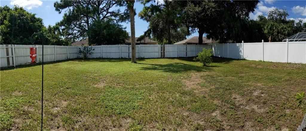 Back Yard - Single Family Home for sale at 236 Cougar Way, Rotonda West, FL 33947 - MLS Number is D6108834