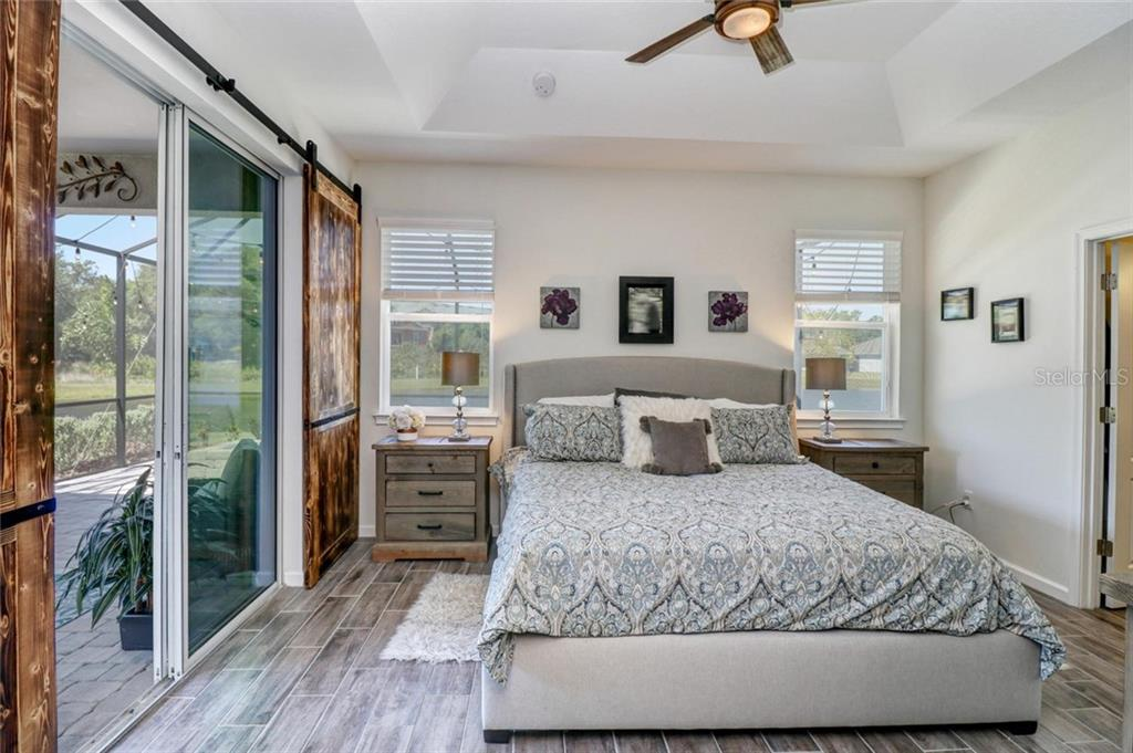 The master suite opens to the lanai and has water views on both sides! - Single Family Home for sale at 5332 Applegate Ct, Bradenton, FL 34211 - MLS Number is T3169261